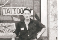 C.J. Danny Danzl in front of his tattoo shop in the 1940's
